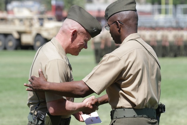 Major General Lawrence D. Nicholson (left), the new commanding general of 1st Marine Division, and Maj. Gen. Ronald L. Bailey, the former commanding general of 1st Marine Division, congratulate each other during a change of command ceremony here, June 10, 2013. Major General Bailey, a native of St. Augustine, Fla., passed command of 1st Marine Division to Maj. Gen. Lawrence D. Nicholson, left, beginning a new era of leadership for the division.