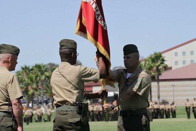 Major General Ronald L. Bailey, the former commanding general of 1st Marine Division, takes the division's colors from Sgt. Maj. David L. Jobe, the 1st Marine Division sergeant major, before he relinquished his command of 1st Marine Division during a change of command ceremony here, June 10, 2013. Major General Bailey, a native of St. Augustine, Fla., passed command of 1st Marine Division to Maj. Gen. Lawrence D. Nicholson (left) beginning a new era of leadership for the division.