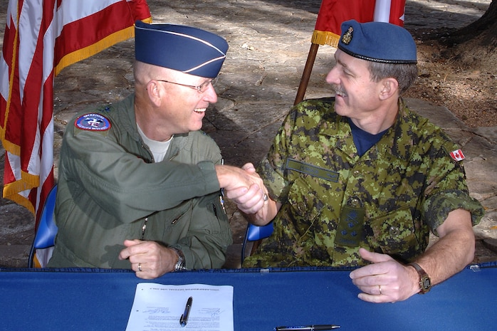 U.S. Air Force Gen. Gene Renuart, left, commander of North American Aerospace Defense Command and U.S. Northern Command, and Canadian Air Force Lt.-Gen. Marc Dumais, commander of Canada Command, signed a Civil Assistance Plan that allows the military from one nation to support the armed forces of the other nation during a civil emergency. The signing took place at U.S. Army North headquarters, Fort Sam Houston, Texas, Feb. 14, 2008.