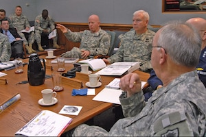 Lt. Gen. H Steven Blum, left, chief of the National Guard Bureau, and Lt. Gen. William Webster, center, deputy commander of U.S. Northern Command, discuss the 2007 military response to Hurricane Dean during USNORTHCOM's Hurricane Preparation Conference at Peterson Air Force Base, Colo., on March 14, 2008. Adjutants general from hurricane-prone states and territories participated in the third annual conference, along with representatives from the Department of Homeland Security, FEMA, Navy, Coast Guard, Army, Air Force and Canada Command.