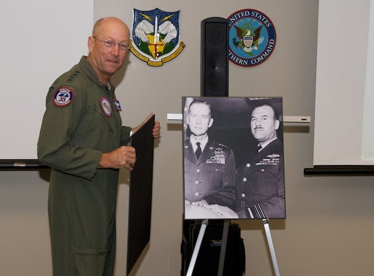 Commander of NORAD and USNORTHCOM, Gen. Gene Renuart, unveils a photo of Gen. Earl Partridge and Air Marshal Roy Sleman recently. Renuart recently approved re-naming of the Large Conference Room at NORAD and USNORTHCOM headquarters to the Partridge-Sliman Conference room in honor of the foresight and committment to international cooperation the two showed in the formative days of NORAD. Partridge was the first commander of NORAD and Sleman the first deputy.