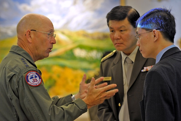 Gen. Gene Renuart, commander of North American Aerospace Defense Command and U.S. Northern Command, talks with military and civilian representatives from Singapore at NORAD's and USNORTHCOM's Homeland Defense and Civil Support Perspectives Forum in Colorado Springs, Colo., Oct. 31, 2008. About 60 officials from Australia, Canada, Mexico, Norway, Singapore, the United Kingdom and the United States met to discuss methods of and ways to improve Homeland Defense and Civil Support processes.