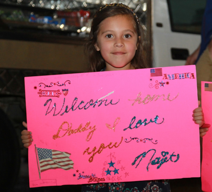 Najet Martinez, 6, holds up a sign for her father, Staff Sgt. Calixtro Martinez, during Marine Unmanned Aerial Squadron 3's homecoming, May 19.
