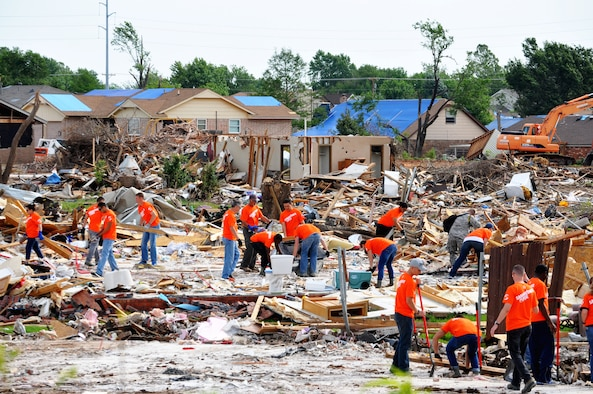 A group of airmen volunteers from Sheppard Air Force Base, Texas, work with Samaritan's Purse to clear the rubble from the foundation of what used to be house June 8, 2013. The foundation is all that remains after an EF-5 (Enhanced Fujita Scale) tornado tore through Moore, Okla. May 20. The tornado destroyed Briarwood Elementary School and Plaza Towers Elementary School. (U.S. Air Force photo/Kimberly Goff /Released)