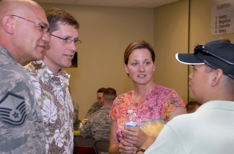 Members of the Oregon Air National Guard, friends and family met on base for the lesbian, gay, bisexual, transgender (LGBT) potluck June 8, 2013. This event, a first for the Air National Guard, was designed to create a bridge in the military community. (from left to right in photo) Master Sgt. David Brunstad, Darin Brunstad, Maj. Lisa Scott and Staff Sgt. Ijigale Beltran. (Air National Guard photo by Staff Sgt. Brandon Boyd, 142nd Fighter Wing Public Affairs)