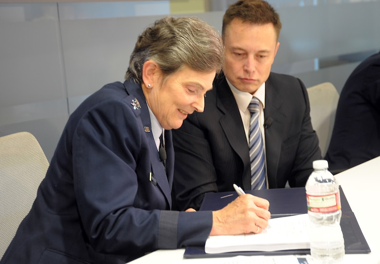 Lieutenant General Ellen Pawlikowski, SMC commander, and Elon Musk, SpaceX CEO, sign a Cooperative Research and Development Agreement to certify the Falcon 9 v1.1 Launch System for National Security Space missions at a ceremony, June 7. The CRADA will be in effect until all certification activities are complete. While certification does not guarantee a contract award, it does enable a company to compete for launch contracts. (Photo by Joe Juarez)