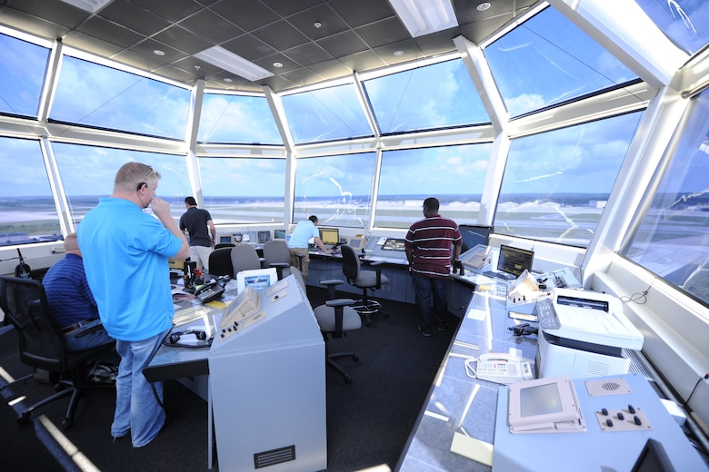 Air traffic controllers direct air and ground operations atop the new ATC control tower at Pope Field, N.C., on June 11, 2013.  The new tower is Leadership in Energy and Environmental Design (LEED) certified, stands 11 stories tall and boasts more than 9,000 square feet of internal space.  (Editor's note: the windows of the tower have been blurred substantially to reduce the resolution of the area it oversees) (Air Force photo by Tech. Sgt. Peter R. Miller)