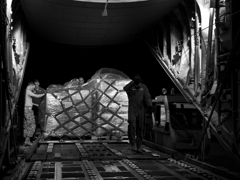 Airmen from the 317th Airlift Group (AG) load humanitarian supplies onto a C-130J in support of the Denton Program June 4, 2013, at Dyess Air Force Base, Texas. The Denton Amendment allows U.S. military aircraft to transport, on a space-available basis, humanitarian supplies from non-government organizations to people around the world who are in need of assistance. The 317th AG transported the supplies to Pope Army Airfield, N.C., where it will be taken to Joint Base Charleston Air Base, S.C., and then to Afghanistan. The supplies were donated by Global Samaritan Resources. (U.S. Air Force photo by Senior Airman Jonathan Stefanko/Released)