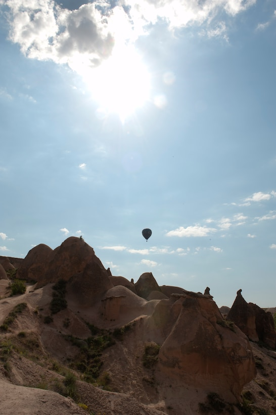A hot air balloon soars over Imagination Valley May 5, 2013, in Nevsehir Province, Turkey. Hot air ballooning in the Cappadocia region is one of the most popular attractions in the area, allowing visitors a bird's eye view. (U.S. Air Force photo by Senior Airman Daniel Phelps/Released)