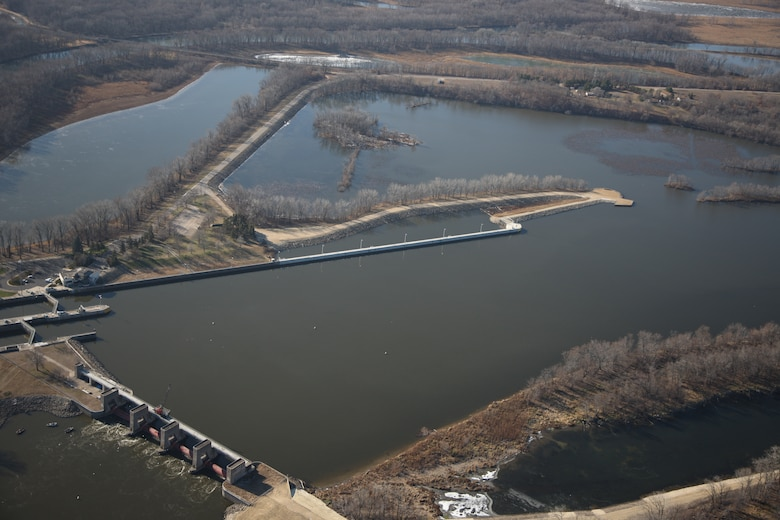 Aerial image of Lock and Dam 3 showing one of the new features, the extended 862-foot upstream guidewall. A ribbon cutting ceremony is held at Lock and Dam 3 in Welch, Minn., May 31, 2013. The event  signified the completion of the nearly $70 million dollar project that significantly improves the navigational safety of boats entering the lock.