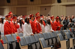 The Quantico Middle/High School's 2013 graduating class waits to be seated at the start of their graduation ceremony at Little Hall's theatre on June 7, 2013. There were 21 Quantico students in the graduating class.