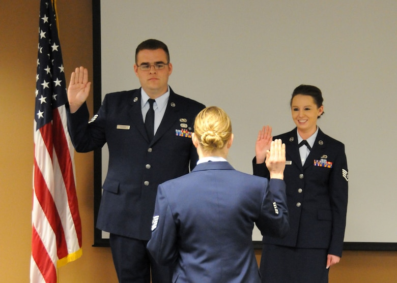 Tech. Sgt. Tammy Wajer, 120th Maintenance Operations Squadron member, leads Staff Sgt. Jack Gaskins, 120th Logistics Readiness Squadron member, and Staff Sgt. Paige Held, 120th Force Support Squadron member, in the recitation of their oath during the NCO Induction Ceremony held at the 120th Fighter Wing on April 7. (U.S. Air Force Photo/Senior Master Sgt. Eric Peterson)