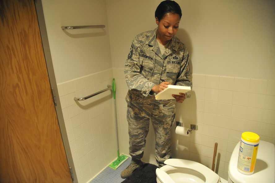 Master Sgt. Lafoundra Thompson, 509th Operations Group first sergeant, inspects a toilet at Whiteman Air Force Base, Mo., June 3, 2013. Depending on the first sergeant's preferences, the cleanliness of a restroom can outweigh a well-vacuumed floor. (U.S. Air Force photo by Airman 1st Class Keenan Berry/Released)