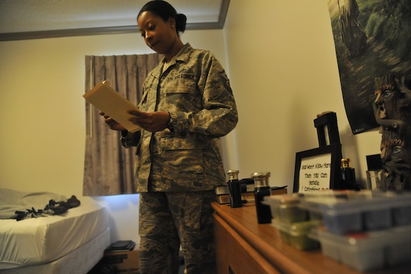 Master Sgt. Lafoundra Thompson, 509th Operations Group first sergeant, reviews an inspection checklist at Whiteman Air Force Base, Mo., June 3, 2013. The checklist is used to ensure each Airman meets specified guidelines during the room inspection. (U.S. Air Force photo by Airman 1st Class Keenan Berry/Released)