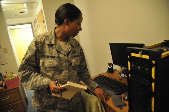 Master Sgt. Lafoundra Thompson, 509th Operations Group first sergeant, performs a standard dorm inspection at Whiteman Air Force Base, Mo., June 3, 2013. One thing inspectors look for is high levels of dust in the dorms, because dust can spread throughout a room, aggravating allergies and polluting electronic equipment. (U.S. Air Force photo by Airman 1st Class Keenan Berry/Released)