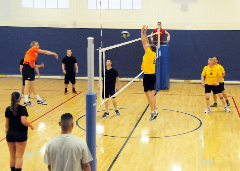 Senior Master Sgt. Steve Shovlin jumps to block a spike sent over the net by a member of the opposing team during the final Montana Air National Guard Vigilantes volleyball game played during the season playoffs held at the Malmstrom Fitness Center on May 14, 2013.  (U.S. Air Force photo/Senior Master Sgt. Eric Peterson)