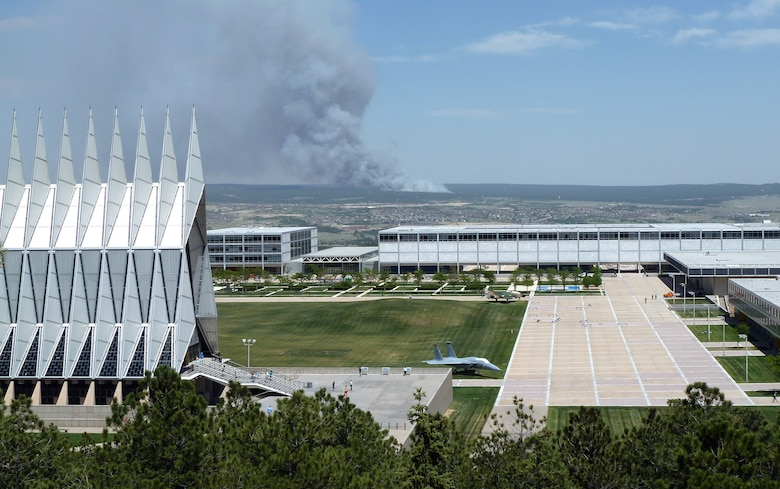 The Black Forest Fire smolders several miles east of the Air Force Academy in Colorado Springs, Colo., in this shot taken near the Cadet Chapel June 11, 2013. The fire burned between 7,500 and 8,000 acres the first day, as well as up to 100 homes. More than 5,000 people were evacuated from an additional 1,700 homes. (U.S. Air Force photo/Rich Droll)