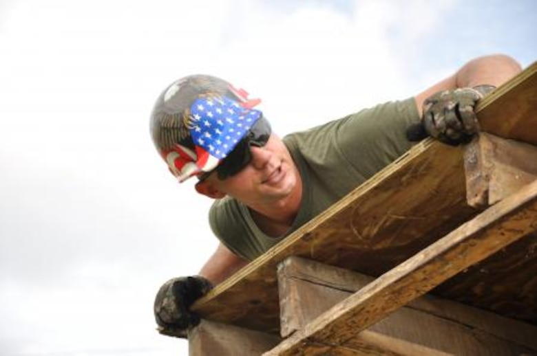U.S. Marine Corps Sgt. Maximilian Beres, combat engineer from the Marine Wing Support Squadron 472, installs roof decking to repair a roof at Hattieville Government Pre-School June 4, 2013, as part of an exercise called New Horizons. Using excess building materials, the civil engineers plan to repair the leaky roof. Civil Engineers from both the U.S. and Belize are constructing various structures at schools throughout Belize as part of an exercise called New Horizons. Building these facilities will support further education for the children of the country and provide valuable training for U.S. and Belizean service members. (U.S. Air Force photo/Capt. Holly Hess)