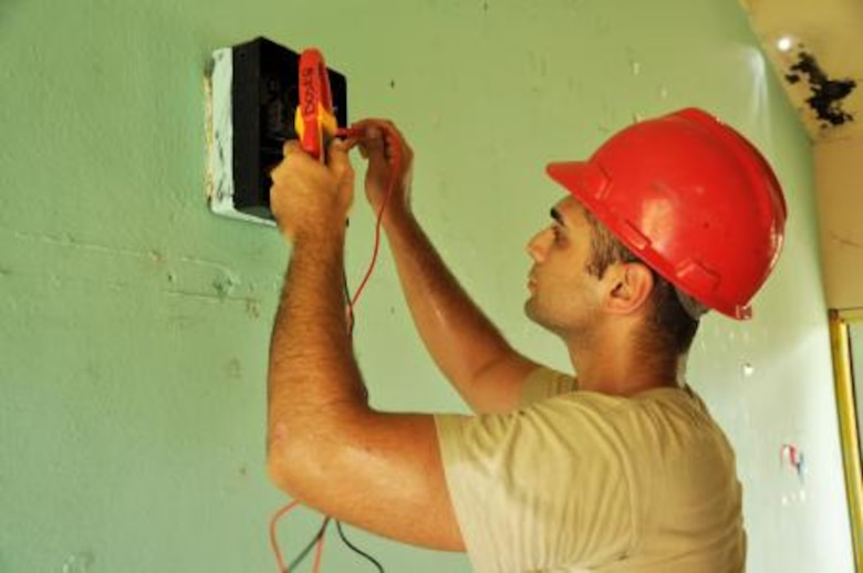 U.S. Air Force Staff Sgt. Serkan Acar, electrician from the 823rd RED HORSE Squadron, troubleshoots the electrical system of Hattieville Government Pre-School June 4, 2013, as part of an exercise called New Horizons. Using excess building materials, civil engineers plan to repair the leaky roof of the school. Civil Engineers from both the U.S. and Belize are constructing various structures at schools throughout Belize as part of an exercise called New Horizons. Building these facilities will support further education for the children of the country and provide valuable training for U.S. and Belizean service members. (U.S. Air Force photo/Capt. Holly Hess)