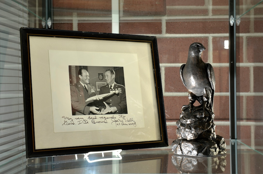 """MCGHEE TYSON AIR NATIONAL GUARD BASE, Tenn. –  Memorabilia of U.S. Air Force Maj. Gen. I.G. Brown is displayed in the lobby of Patriot Hall here at the I.G. Brown Training and Education Center. In a framed photo, Brown as a brigadier general holds a model aircraft with then Lt. Gen. Joe W. Kelly, later the first four star commander of the U.S. Air Force's Military Air Transport Service. Kelly's autograph reads, """"My best regards to Gen. I.G. Brown."""" Brown later became the first Director of the Air National Guard and is credited with founding the Center dedicated in his name. (U.S.  Air National Guard photo by Master Sgt. Kurt Skoglund/Released)"""