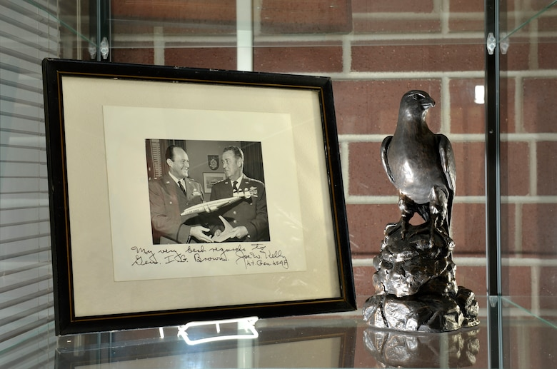 "MCGHEE TYSON AIR NATIONAL GUARD BASE, Tenn. –  Memorabilia of U.S. Air Force Maj. Gen. I.G. Brown is displayed in the lobby of Patriot Hall here at the I.G. Brown Training and Education Center. In a framed photo, Brown as a brigadier general holds a model aircraft with then Lt. Gen. Joe W. Kelly, later the first four star commander of the U.S. Air Force's Military Air Transport Service. Kelly's autograph reads, ""My best regards to Gen. I.G. Brown."" Brown later became the first Director of the Air National Guard and is credited with founding the Center dedicated in his name. (U.S.  Air National Guard photo by Master Sgt. Kurt Skoglund/Released)"