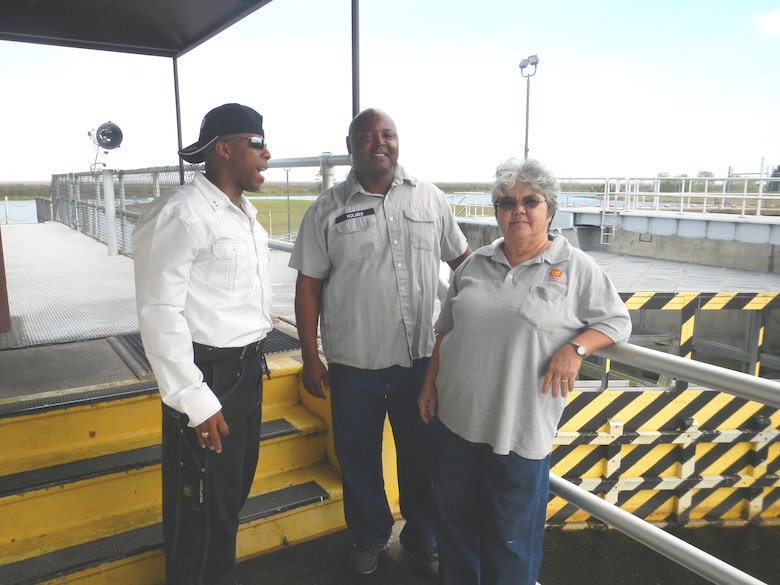 Adam Morrison (left),  Jacksonville District Equal Employment Opportunity Office, visited lock leader Pam Peralta (right) and lock operator Robert Holmes (center) at Moore Haven Lock and Dam on the Okeechobee Waterway.