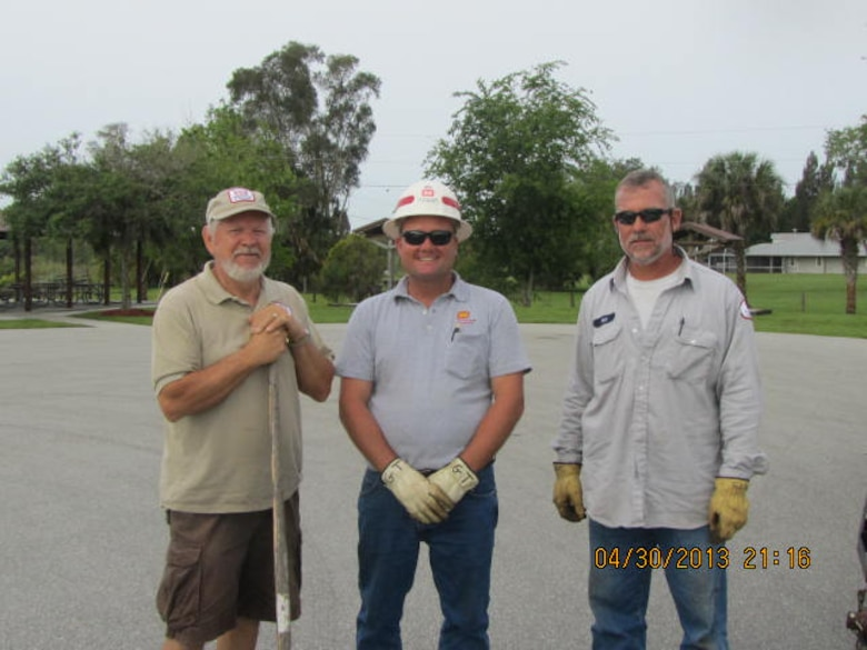 Donald Chapman (left), one of the Corps' many volunteers, joined Corps employees Thompson Graham (center) and Dan Finke (right) to prepare planting areas for Take Pride in America Day.