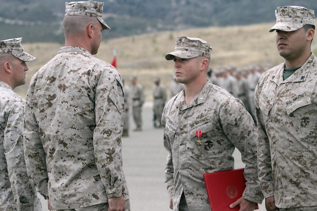 """First Lt. Stephen C. Huff, the 81 mm mortar platoon commander serving with 1st Battalion, 1st Marine Regiment, is presented the Bronze Star Medal with Combat """"V"""" for valor here, June 11, 2013. Huff, led more than 50 Marines and Afghan soldiers in an assault on an insurgent stronghold of more than 25 highly trained fighters. During the 60 hour fight, he exposed himself to enemy fire while maneuvering his Marines, directing their fire and evacuating the casualties from the battlefield."""
