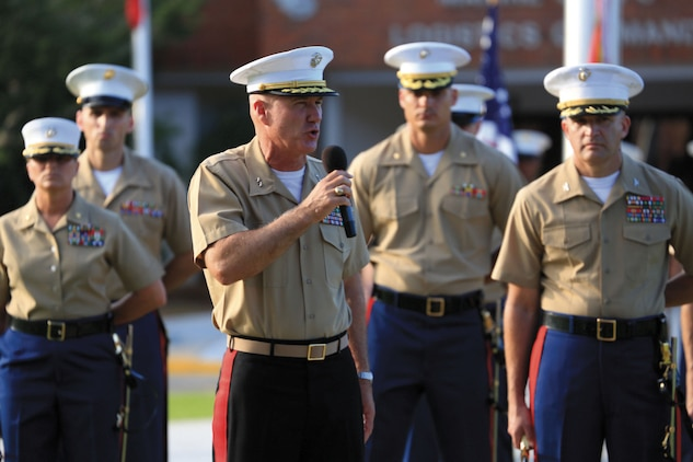 Maj. Gen. Charles L. Hudson, outgoing commanding general, Marine Corps Logistics Command, addresses Marines, Civilian-Marines, Sailors, distinguished guests and friends during his relinquishment of command ceremony, Friday, at MCLC's parade field.