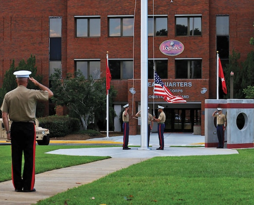 Maj. Gen. Charles L. Hudson salutes the colors Friday as they are retired at sunset during his relinquishment of command ceremony. Hudson will assume his new role as the commanding general of Marine Corps Installations Pacific in Okinawa, Japan.