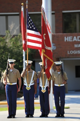 The color guard for Marine Corps Logistics Command presents the national colors and the Marine Corps colors for the relinquishment command of Maj. Gen. Charles L. Hudson during a sunset ceremony at MCLC's parade field June 7.