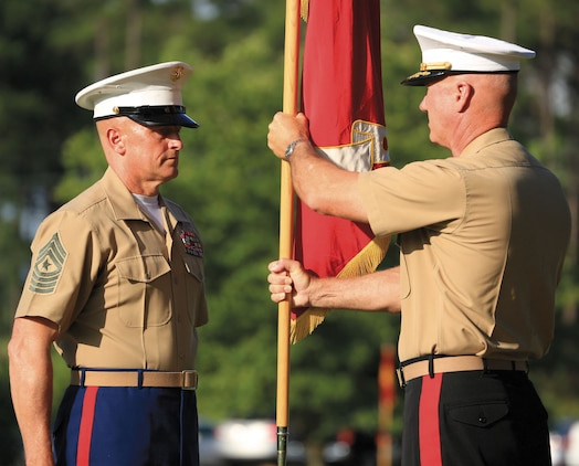 Maj. Gen. Charles L. Hudson, right, outgoing commanding general, Marine Corps Logistics Command, returns the MCLC's colors and battle streamers to Sgt. Maj. Joseph M. Davenport III, sergeant major, MCLC, Friday, during a relinquishment of command ceremony held at MCLC's parade field.
