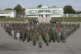 Representatives from various Asia-Pacific nations gather for a multinational group photo during the Association of Southeast Nations Defence Ministers Meeting-Plus ASEAN Humanitarian Assistance/Disaster Relief and Military Medicine Exercise hosted by Brunei Darussalam June 12 at Berakas, Brunei. More than 1,800 multinational personnel from 18 Asia-Pacific nations are participating in the ASEAN exercise, which provides a platform for regional partner nations to address shared security challenges, strengthen defense cooperation, enhance interoperability and promote stability in the region. ASEAN is comprised of Brunei, Cambodia, Indonesia, Laos, Malaysia, Myanmar (Burma), Philippines, Singapore, Thailand and Vietnam. Non-ASEAN countries include Australia, China, India, Japan, New Zealand, Republic of Korea, Russia and the U.S. The exercise is scheduled from June 16 to 20. (U.S. Marine Corps photo by Lance Cpl. Allison Bak/Released)