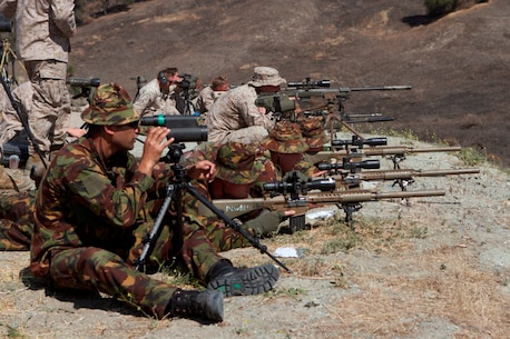 New Zealand and Canadian Army snipers shoot side-by-side with scout snipers serving with 1st Reconnaissance Battalion and 1st Battalion, 1st Marine Regiment, at Range 108 during Exercise Dawn Blitz 2013 here, June 12. Throughout the day of shooting, the snipers shared different tips and techniques taught by their different units and schools. During the live-fire exercise, the snipers engaged known distance, unknown distance and one-shot-one-kill targets up to 1,200 meters away. Dawn Blitz 2013 is a scenario-driven exercise designed to test Navy and Marine Corps forces at the Marine Expeditionary Brigade (MEB) and Expeditionary Strike Group (ESG) level, while promoting military-to-military cooperation and interoperability with partnered nations.