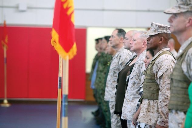 Senior leaders of III Marine Expeditionary Force and Marine Corps Installations Pacific stand at attention during the conclusion of a change of command ceremony June 12 at Camp Courtney. Brig. Gen. Craig Q. Timberlake (2nd from the right), relinquished command to Col. John A. Ostrowski. Brig. Gen. Paul J. Kennedy will assume command later this summer. Timberlake will be the deputy commanding general, Regional Command North, International Security Assisstance Force, Afghanistan.