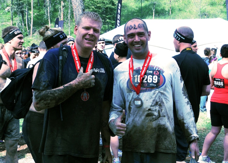 Race participants pose with their medals at the finish of the 2013 Spartan Sprint held near Bigfork, Mont. May 11. (U.S. Air Force photo/Tech. Sgt Brett McCloney)