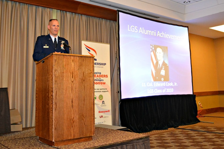 New York Air National Guard Lt. Col. Edward Cook addresses over a hundred Central New York community leaders during his acceptance speech for the Leadership Greater Syracuse Alumni Achievement Award presented during a ceremony held on April 24, 2013.  Lt. Col. Cook serves as the Logistrics Readiness Squadron Commander for the 174th Attack Wing, Hancock Field Air National Guard Base, Syracuse, New York.  (photo by New York Air National Guard Lt. Col. Catherine Hutson/Released).