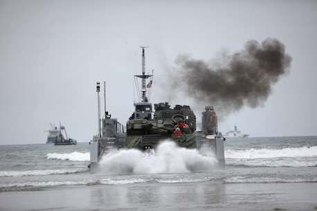 An amphibious assault vehicle lands ashore after departing off a Maritime Prepositioning Force ship during an offloading exercise aboard Coronado, Calif., June 13, 2013. The exercise was conducted as part of Dawn Blitz 2013, a joint Marine and Navy amphibious training operation. (U.S. Marine Corps photo by Lance Cpl. Shaltiel Dominguez/Released)