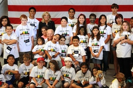 Vice President Joe Biden and his family take a group photo with the children of the Tragedy Assistance Program for Survivors at Marine Corps Air Station Camp Pendleton during their four-day Good Grief Camp here, June 14. Biden and the children share stories, experiences and laughs as they sit and talk to him while enjoying a scoop of ice cream. T.A.P.S. is a program to help children cope with the loss of a loved one while serving in the military.