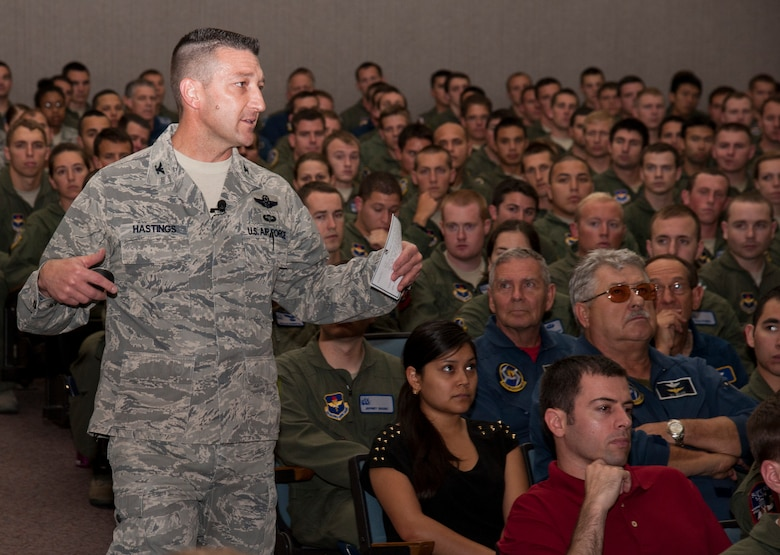Col. Brian Hastings, 47th Flying Training Wing commander, briefs members of the 47th Operations Group about sexual assault prevention at Anderson Hall on Laughlin Air Force Base, Texas, June 14, 2013. The briefing was the first of many scheduled to take place here between June 14 and June 19 as part of the secretary of defense directed Sexual Assault Prevention and Response Stand-down Day. (U.S. Air Force photo/Senior Airman Nathan Maysonet)