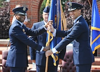 Lt. Gen. Darren McDew, 18th Air Force commander, presents the 375th Air Mobility Wing flag to Col. Kyle Kremer signifying the start of Kremer's command of the wing during a ceremony June 14 at Scott Air Force Base, Ill. Kremer arrived from McConnell Air Force Base, Kan., where he served as the vice commander of the 22nd Air Refueling Wing. (U.S. Air Force photo/Airman Kristina Forst)