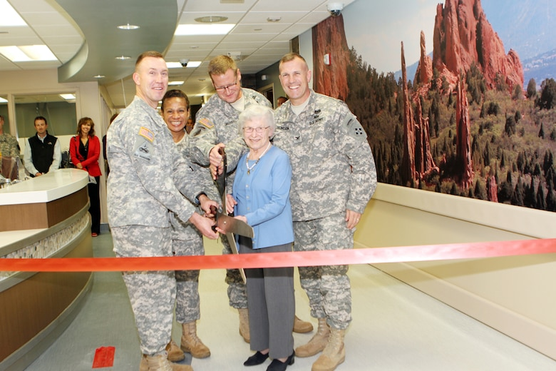Col. John McGrath (MEDDAC commander), CSM Donna Brock (MEDCOM CSM and Senior Enlisted Advisor to the Surgeon General), Fort Carson Commander Col. David Grasso, Mrs. Ella Cochrane (spouse of former Evans commander Col. Gharles Cochrane) and Col. John Thomson (Deputy Commander 4th Infantry Division) cut the ribbon to officially open the Evans Army Community Hospital's Family Care Ward.