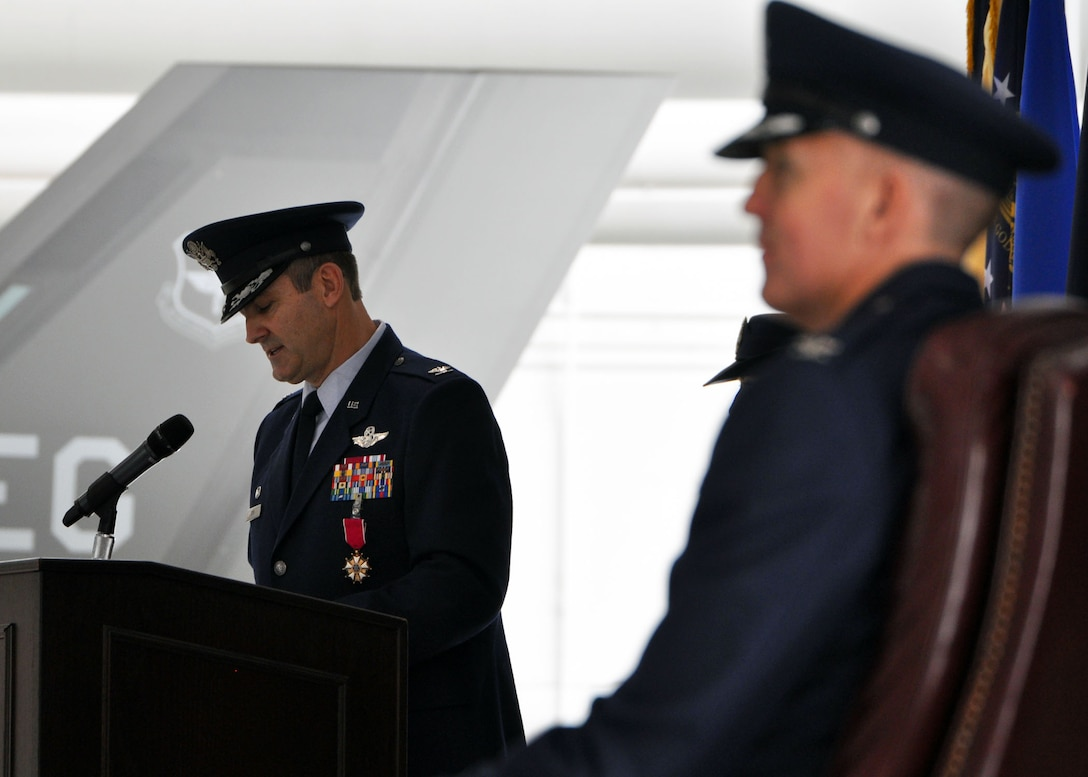 Col. Andrew Toth addresses the 33rd Fighter Wing for the last time as commander while his replacement, Col. Todd Canterbury, waits in the wings during the change of command ceremony June 14 at Eglin Air Force Base, Fla. Canterbury took command of the wing from Toth, who leaves to become director of assignments at Joint Base San Antonio-Randolph, Texas. (U.S. Air Force photo/Staff Sgt. Nicholas Egebrecht)