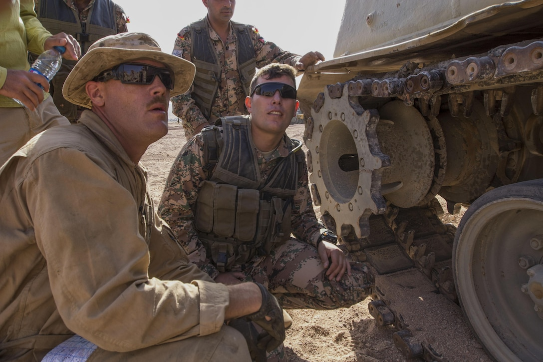 U.S. Marine Gunnery Sgt. Jonathon Griffith, ordnance maintenance chief with maintenance detachment, Combat Logistics Battalion 26, 26th Marine Expeditionary Unit (MEU), and Idaho Falls, Idaho, native, assesses damage to a Jordanian Armed Force's M88A1 during Exercise Eager Lion 2013 in Al Quweira, Jordan, June 13, 2013. Exercise Eager Lion 2013 is an annual multinational exercise designed to strengthen military-to-military relationships and enhance security and stability in the region. The 26th MEU is a Marine Air-Ground Task Force forward-deployed to the U.S. 5th Fleet area of responsibility aboard the Kearsarge Amphibious Ready Group serving as a sea-based, expeditionary crisis response force capable of conducting amphibious operations across the full range of military operations. (U.S. Marine Corps photo by Cpl. Kyle N. Runnels/Released)