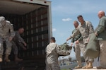 U.S. Army North personnel load their bags into a truck for transportation from Fort Sam Houston, Texas, to Camp Mabry, Texas, on Sept. 13, 2008. About 75 servicemembers and Department of Defense civilians are setting up their operational command post near the Joint Field Office just outside of Austin. U.S. Northern Command is supporting federal, state and local Hurricane Ike response efforts in Texas.