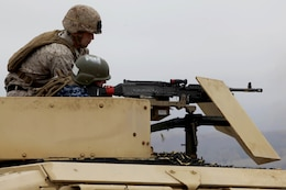 Midshipman 3rd Class Lauren Hunt fires a mounted M240-B during Marine Week of Career Orientation and Training for Midshipmen-West 2013 here June 12. Future officers from across the U.S. participated in the four-weeks of training designed to introduce them to career opportunities.