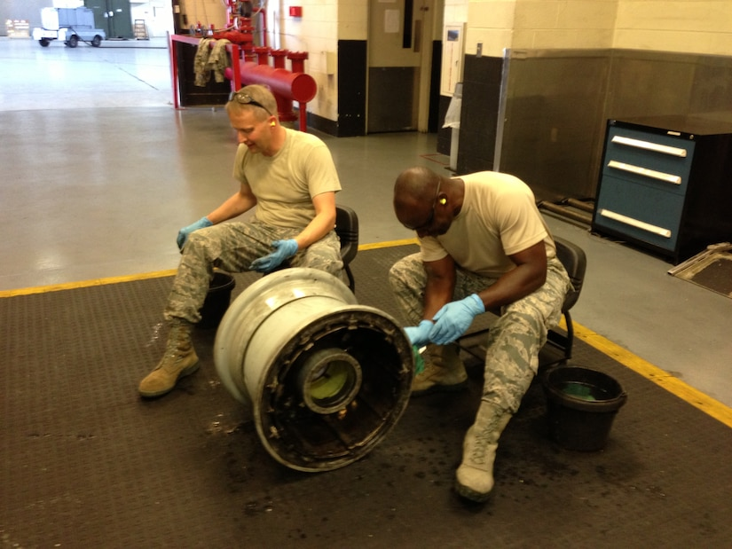 Col. Darren Hartford, 437th Airlift Wing commander, and Col. Dennis Dabney, 437th Maintenance Group commander, visited the 437th Maintenance Squadron Wheel and Tire shop, June 13, 2013, at Joint Base Charleston – Air Base, S.C. Hartford and Dabney pitched in to help perform maintenance on C-17 wheel assemblies. (U.S. Air Force photo/ Master Sgt. Robert Wilkinson)