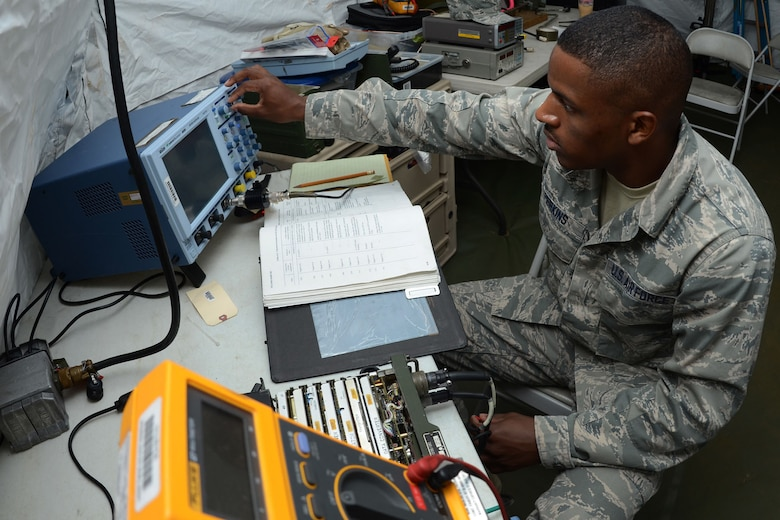 U.S. Air Force Airman James Perkins, an airfield systems apprentice with the 245th Air Traffic Control Squadron at McEntire Joint National Guard Base, South Carolina Air National Guard, performs radio maintenance for the 245th ATCS mobile tower set up at Shaw Air Force Base, Sumter S.C., June 13, 2013. The 245th ATCS sent personnel to Shaw to set up and train Shaw's controllers on operating the mobile tower while renovations are being made to their control tower. (U.S. Air National Guard photo by Senior Master Sgt. Edward Snyder/Released)