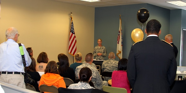 Army Maj. Emily Norton (center) addresses a crowd of Army supporters, future soldiers, and members of the community, during the grand opening of the Army Career Center in Mission Viejo, Calif., June 14.