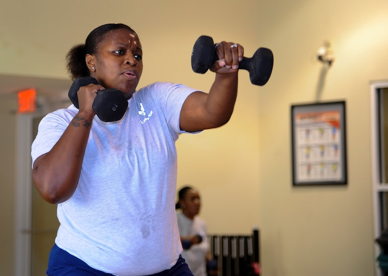 Staff Sgt. Marcia Deloach, 1st Special Operations Aerospace Medicine Squadron public health technician worksout during a Post Pregnancy physical training session at the Riptide Fitness Center on Hurlburt Field, Fla., June 17, 2013. Each session consists of full body movements, pushups, squats and sprints. (U.S. Air Force photo by Airman 1st Class Jeffrey Parkinson)